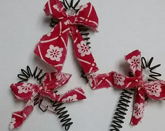 Rusted bed spring candy cane with scrappy fabric bow.  Teacher gift, or tree decor.