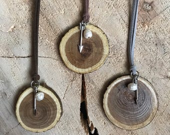 Arrow and pearl wood slice pendant necklace.
