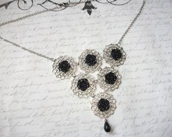 Black flower silver filigree bib necklace