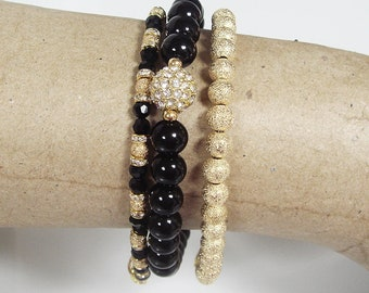 Set of Three Bracelets in Black and Gold