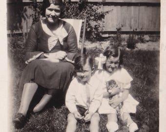 Mother And Children In Garden - Little Girl Cuddling Kitten - Vintage Photo
