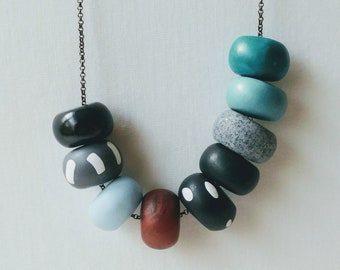 Polymer Clay Bead Necklace. Black,blue,teal,copper,gray statement necklace. Handmade clay necklace. Bold, unique, modern jewelry.