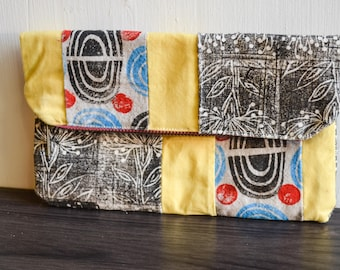 Hand Printed Fold Over Clutch: Floral and Swirl in Yellows/Blues/Black.  Circus Meets Serious in this fun and bright block printed bag.