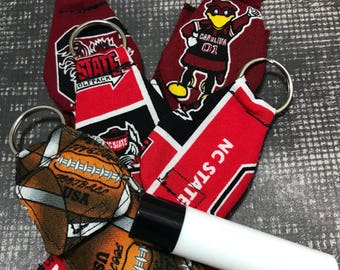Lip balm holder for key chains, bags, and more. Football themed