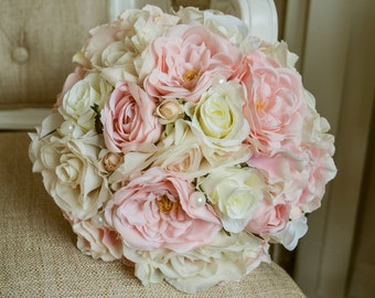 Pink and ivory silk wedding bouquet. Made with artificial roses, hydrangea and pearl details.