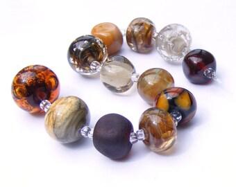 Lampwork orphans - glass bead set of 12 mainly brown renegade beads