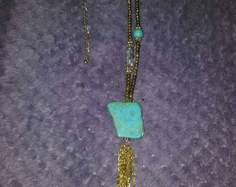 Long gold chair necklace with pendant