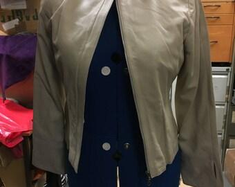 Brand new Women's leather jacket. 100% genuine leather cream jacket