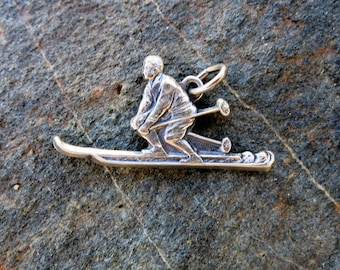 "SILVER SKIER CHARM, Detailed, skier with poles up, Stamped "" Sterling"""