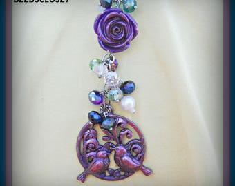 Love Birds Necklace colors are diffrent shades of purple , Lucite purple  flower, pearls and silver toned rolo chain