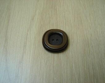 large round dark brown button