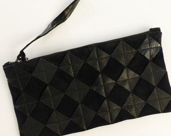 Black on black leather clutch. Repurposed black leather diamond chips on black suede, gunmetal zipper, fully lined.