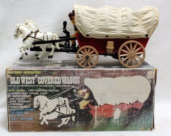 Product of Universal Old West Cowboy Covered Wagon Battery Operated Toy