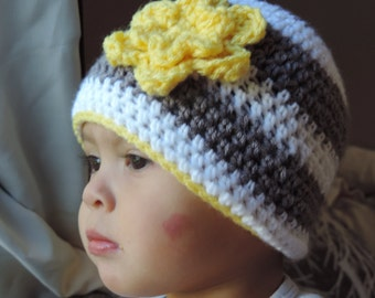 Gray and white stripe hat with yellow flower