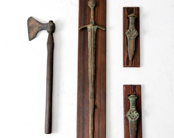 Bronze Age styled weaponry, mounted daggers, sword, and ax