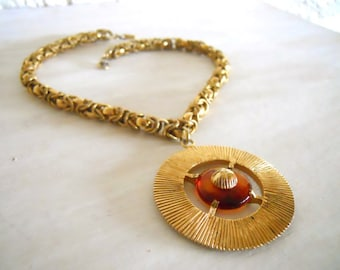 Vintage Gold tone 1960's amulet necklace with faux  tortoise shell disk statement costume jewelry necklace