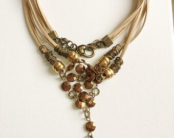 Leather necklace with hematite and mixed metals