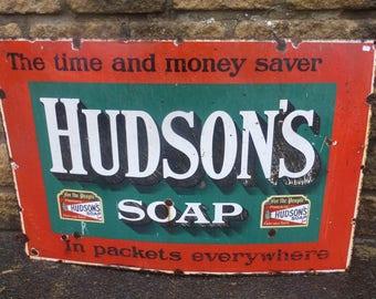 "Hudson's Soap 'In packets everywhere' rectangular enamel sign, 36 x 24"".    1930s"