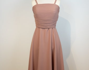 Pale pink cocktail dress with pleated bodice