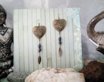 A pair of dangling earrings ethnic bronze with these Indian beads