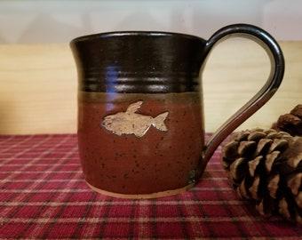 Iron red and black fish stamp mug