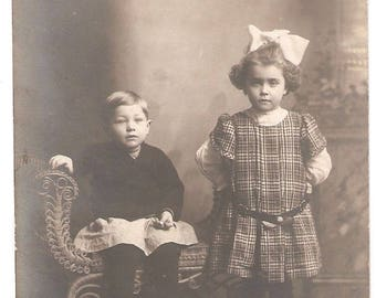 Real Photo Postcard Boy and Girl Fancy Victorian Photographers Chair