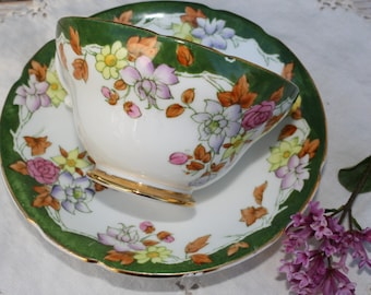 Stanley: green tea cup and saucer, with leaves and flowers