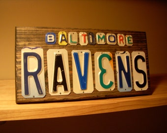 Baltimore Ravens sign made with recycled license plates.