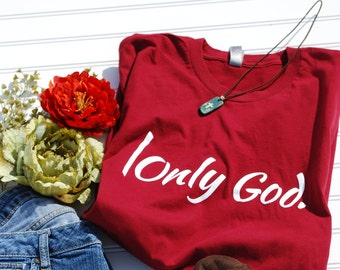 Soft, faith t shirts.  |Only God. is a design that is guaranteed to share your faith!  Red, fitted t-shirt, true to size.
