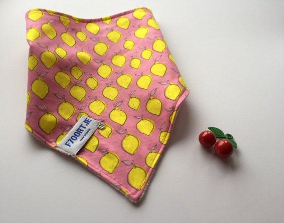 Pink toddler ajustable bandana with lemonprint, and super soft minky back.