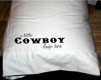 A little cowboy sleeps here pillow case