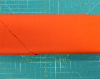 Solid orange fabric. Tangerine Premium Colorworks quilters cotton quilting 9000 590 Northcott 3232