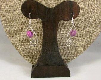 Silver swilrls with purple stones earrings