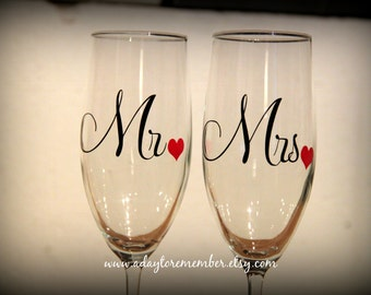 mr and mrs toasting glasses... perfect gift for the newly engaged couple or for the wedding toast!