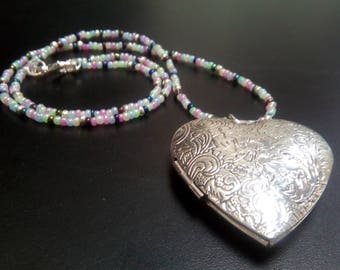 Embossed big heart silver plated locket on hand strung seed bead necklace