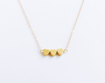 Je T ' aime Three Sisters (necklace) - Three tiny 14k gold plated puffed hearts and 14k Gold Filled chain
