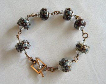 7 Round Brown & Blue Lampwork Beads Bracelet. Toggle Clasp, Antique Bronze Wire Wrapped, Jump Rings Large Wrist