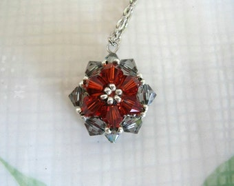 Crystal Starburst Necklace - Orange and Gray Woven Bead Pendant