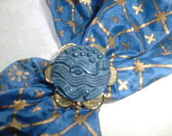 Scarf clip, gold metal flower, with a blue center- pay for 3 different ones  - get  extra one free
