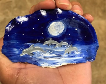 Original hand painted rocks, dolphins ( oyster shell)