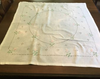 Hand embroidered table cloth.
