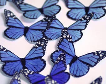 Blue edible butterflies, 12 wafer paper monarch butterflies for cake decorating and cupcake toppers. Butterflies for wedding cake toppers
