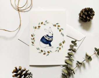 Greeting card with illustration snowshoe hare and pine branches / pine cones / watercolor painting / minimalist design