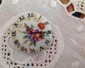 Vintage porcelain cabochon mounted in badges