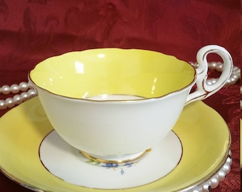 A.B. Jones Grafton English China  Yellow and Rose floral pattern footed Tea cup and saucer