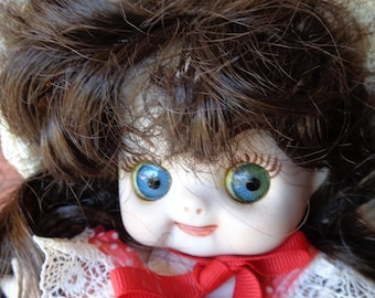 "1976 ooak, Google eyes, all ceramic/bisque 8"" doll, artist signed"