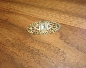 vintage pin brooch goldtone filigree rhinestone