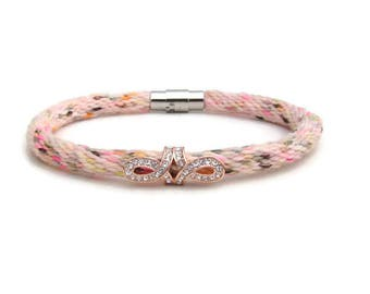 Woven, peach rainbow, hand dyed specialty yarn kumihimo bracelet with rose tone and rhinestone charm and stainless steel magnetic clasp