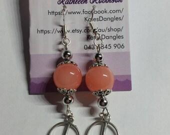 Orange earrings, silver findings, silver earrings,  orange and silver earrings, sterling silver earrings, peace sign earrings