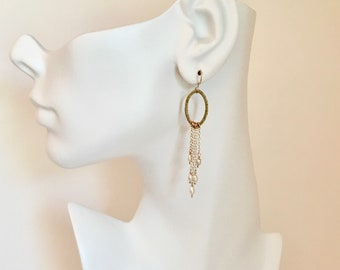 Gold statement earrings with freshwater pearls